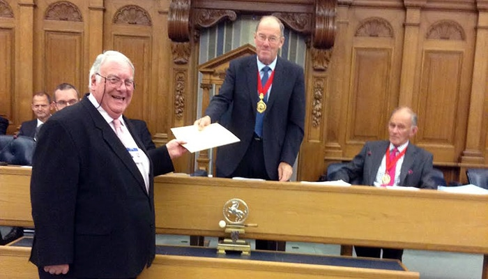 Kent County Councillor, Tom Maddison presents Bridge school places petition to Council